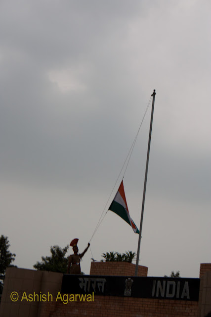A BSF jawan lowering the Indian flag at the Wagah Border between India and Pakistan