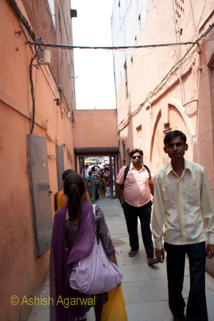 People passing through the small passage that leads to the Jallianwala Bagh memorial in Amritsar