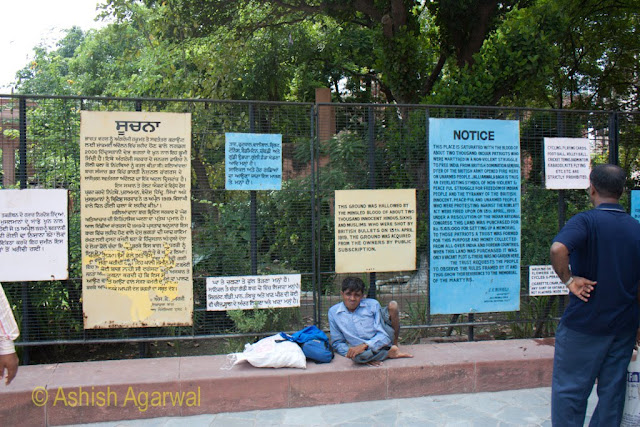Signs at the start of the Jallianwala Bagh complex, meant to convey the history of the place