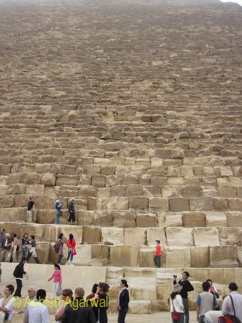 Cairo Pyramids - People at the foot of the Great  Pyramid of Cheops at Giza