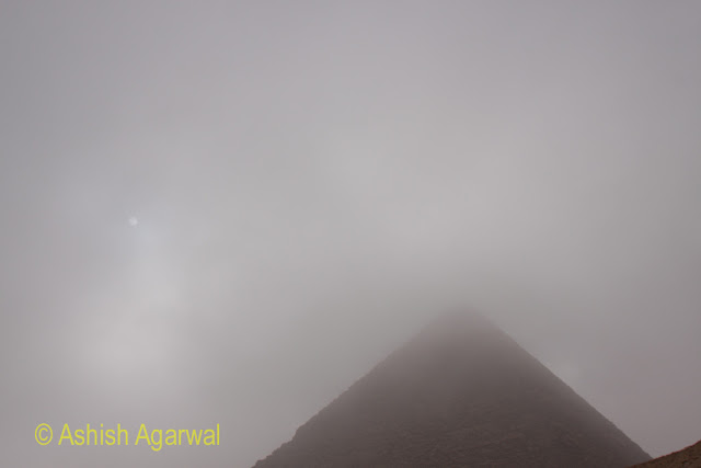 Cairo Pyramids - a lot of cloud and fog covering the Great Pyramid in morning time