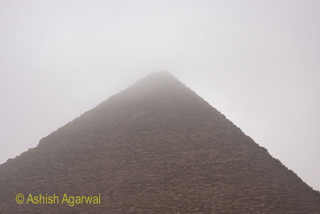 Cairo Pyramids - the top section of the pyramid seems to be missing, with fog