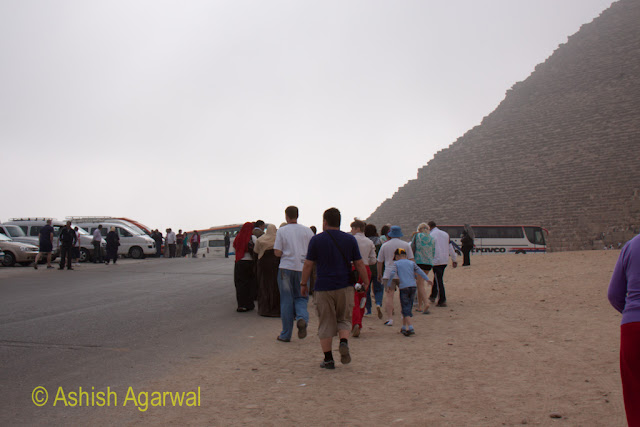 Cairo Pyramids - Tourists heading from their tour buses to the Great pyramid