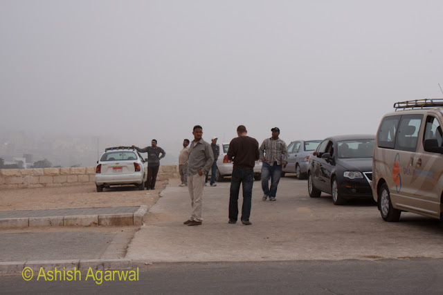 Cairo Pyramids - View of drivers roaming around their vehicles near the Great Pyramid