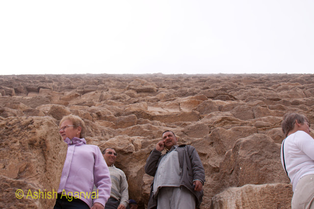Cairo Pyramids - People along a different view of the Great Pyramid, almost a straight shot