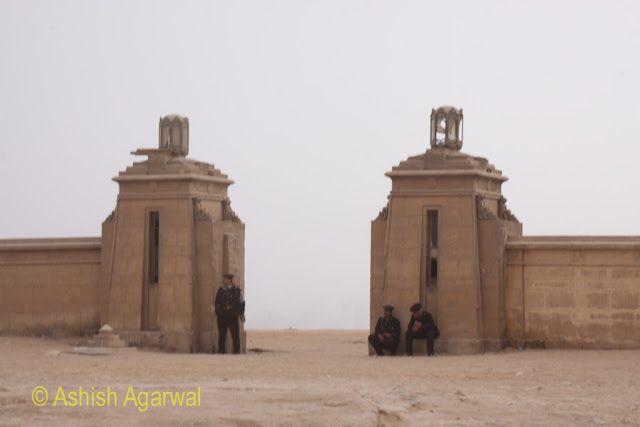 Great Pyramid - The gates at one end of the Pyramids complex, manned by security guards