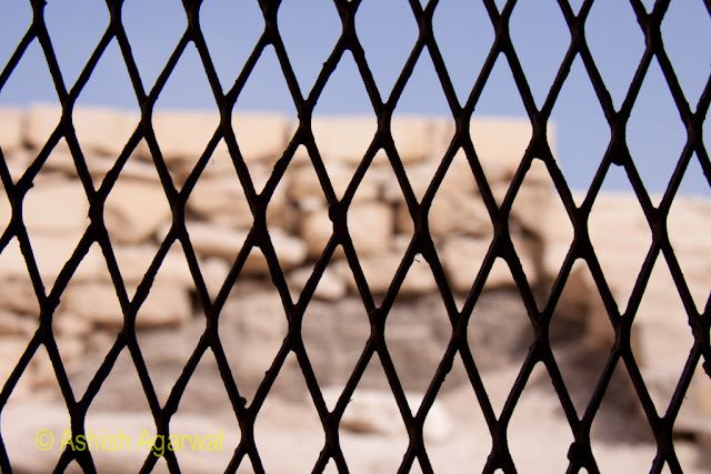Cairo Pyramid - A metal partition in a small structure next to the pyramids