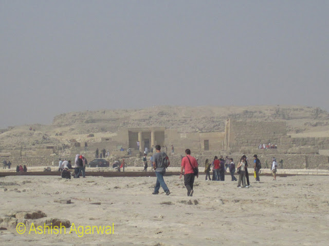 Great Pyramid - People moving towards different structures next to the Great Pyramid of Giza