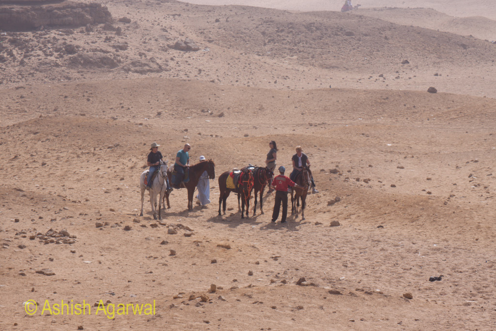 Giza Pyramids - Tourists on horses near the Great Pyramids in Cairo