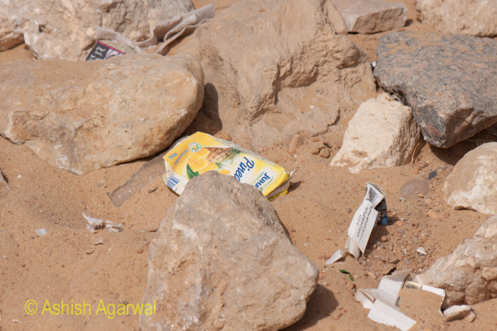 Great Pyramid - View of rubbish in the sands near the Great Pyramid in Giza