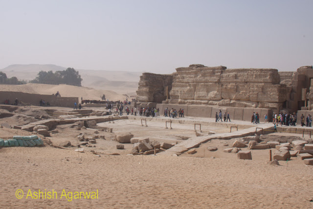 Tourists walking at the edge of the Sphinx in Giza in Egypt