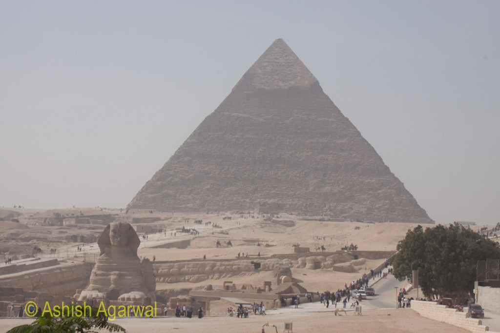 View from the distance that shows both the Great Sphinx and the Great Pyramid in the same photo