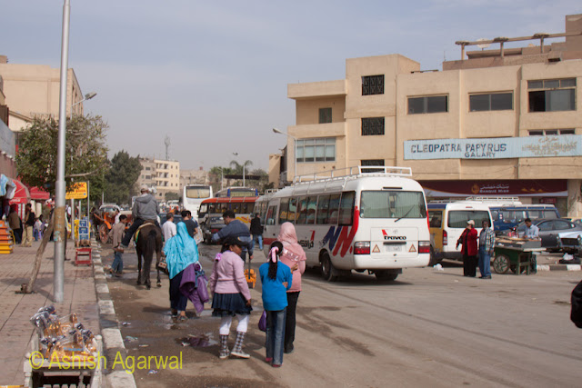Tourists and buses in Giza, just right next to the Sphix and the Great Pyramid