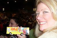 Laura holding a mini Wheelmobile