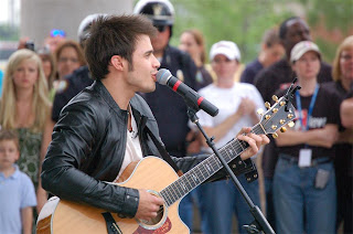 Kris Allen performing at the Riverfest Ampitheatre
