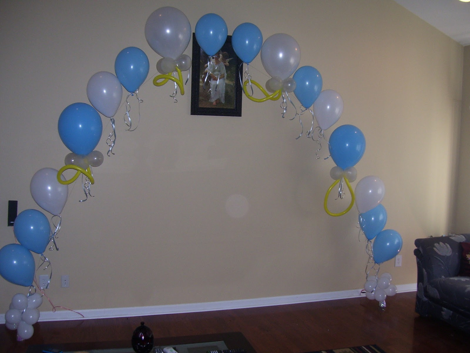 the balloon arch was designed with a pacifier theme