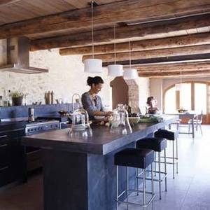 The black smooth and rustic concrete cabinetry definately set off the