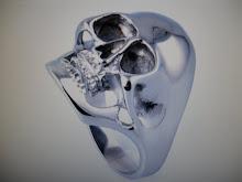 ( 14 )        stainless steel skull ning $25.00
