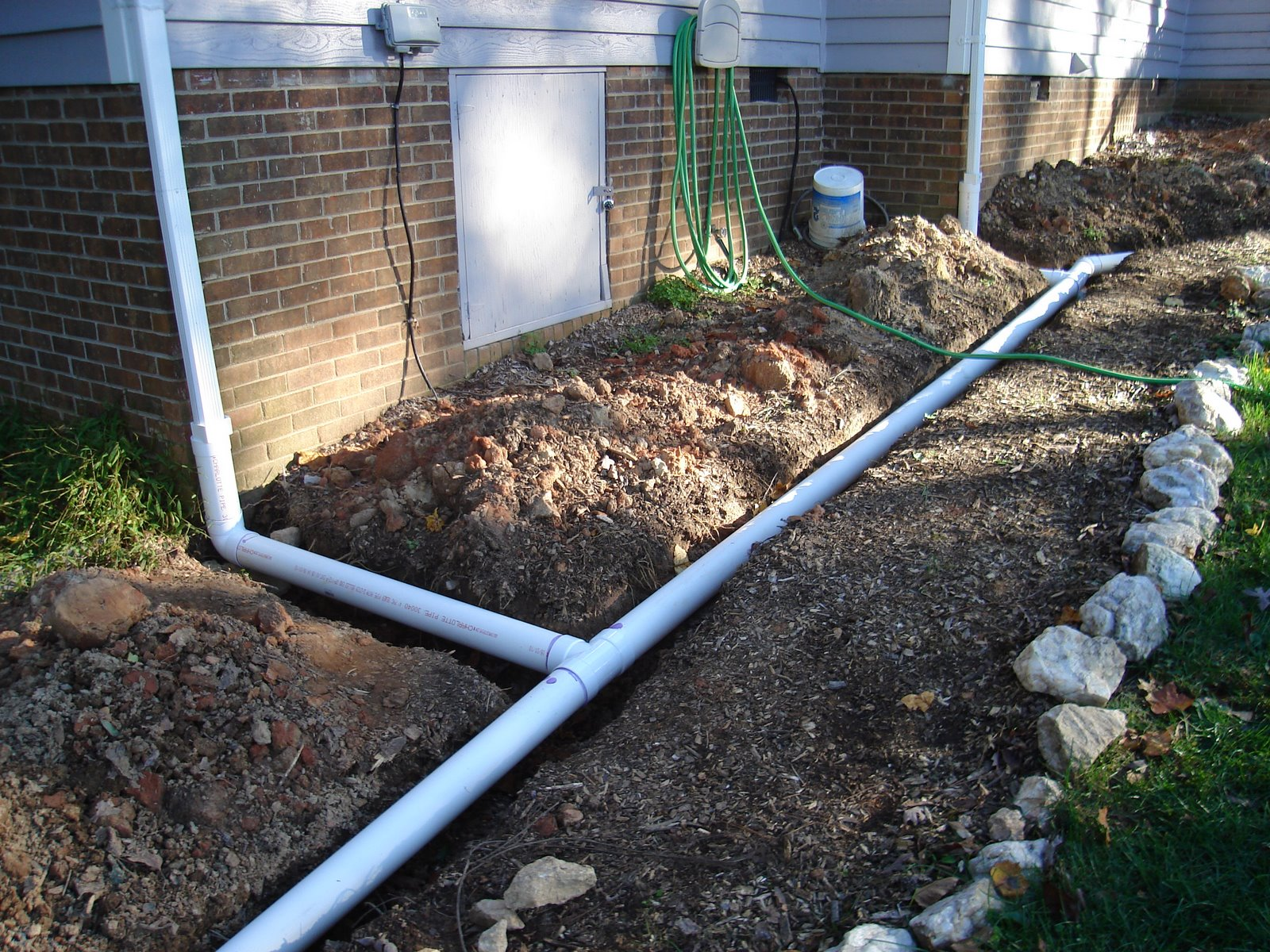 From mind to machine installing a drainage network for Installing drainage pipe around house
