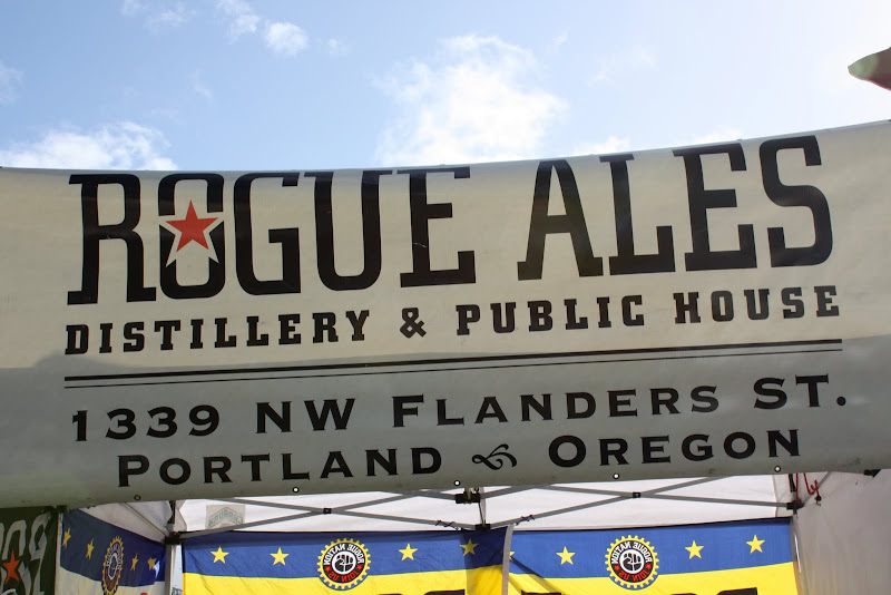 A photo of a banner that reads Rogue Ales
