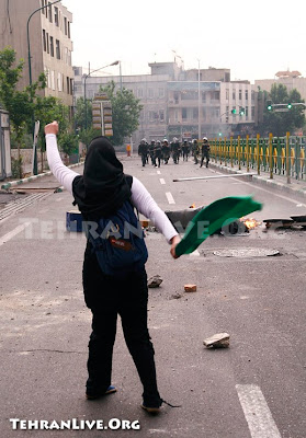 Iranian Woman Holding Flag with Fist in the Air