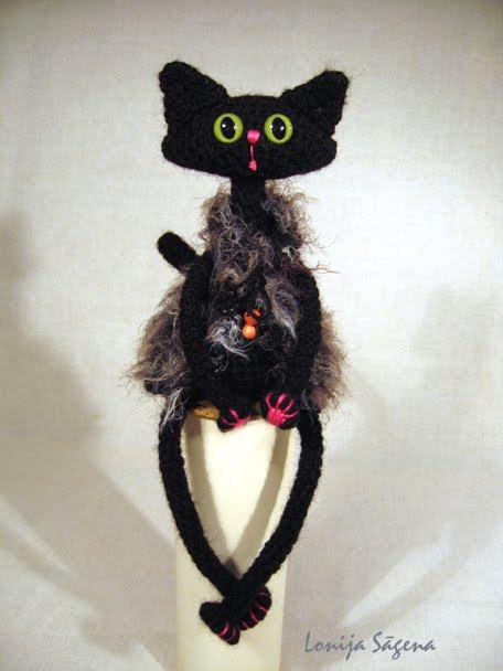 tamborēts kaķis, vestes kaķis, lofonsa