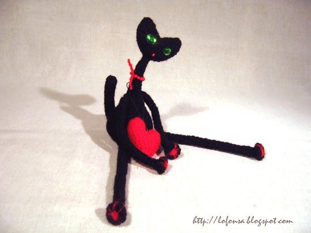 tamborēts melns kaķis ar sirsniņu,lofonsa