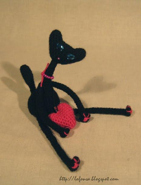 tamborēts melns kaķis,sliņkais kaķis,mīlnieks,lofonsa