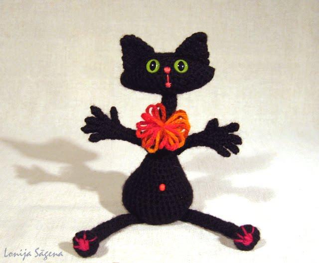 tamborēts melns kaķis,bučiņkaķis,lofonsa