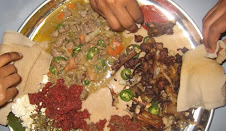 easting with gurusa with different vegetables and meat