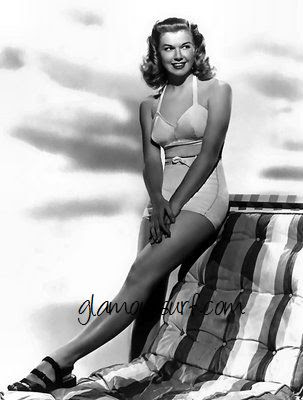 Love this last shot of Doris in a 2 piece swimsuit, such modest heels though ...