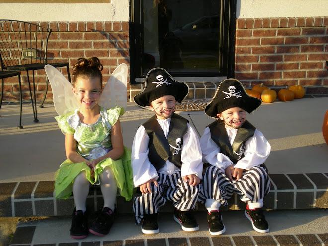 Three kids in costumes