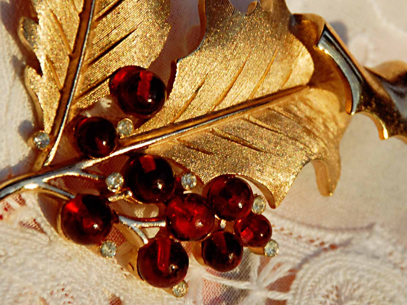 signed Trifari gold holly pin with red