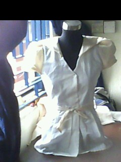 A female shirt completed with collar and puff sleeve