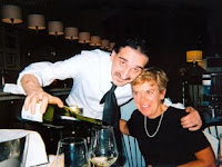 Moreno pouring Nan a glass of vino bianco at La Bussola in Florence