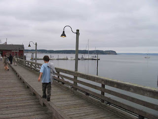 Max walking the rail down the center of the Coupeville Wharf