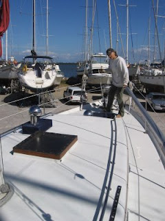Phyllis on the foredeck of Otter II, a 1979 Valiant 40 centerboard model