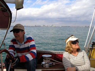 Paul and Honey sailing on Biscayne Bay, with Coconut Grove and Dinner Key in the distant background