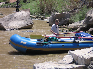 Kurt Beereboom and his whitewater raft in the eddy at 'Little D' rapids in Westwater Canyon