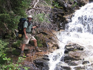 Rich posing at one of the numerous waterfalls along the trail up to Chicago Basin