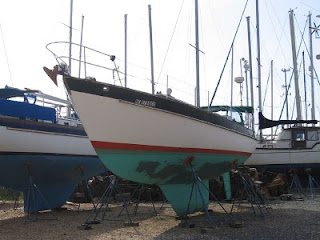 Little Walk sitting in the Spring Cove Marina's boatyard without her mast