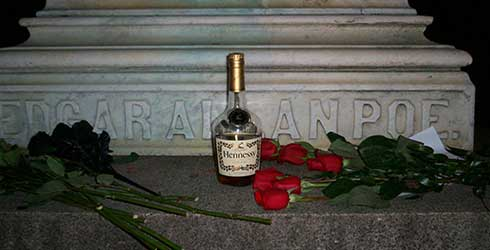 Roses and cognac on the grave of Poe