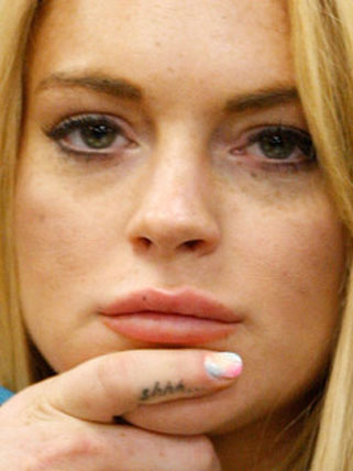 Lindsay Lohan has gotten a new tattoo and went back to her red-haired roots. Lindsay lohan tattoo design images