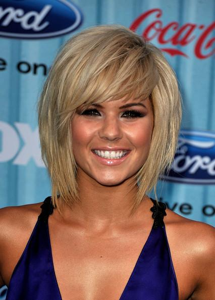 Short straight blonde bob with volume at the crown and a sweeping fringe .