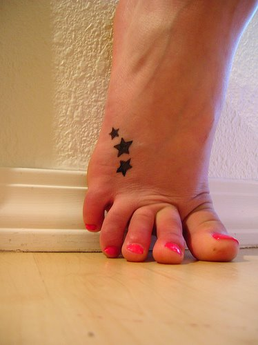 star tattoos on foot designs. stars tattoos on foot. tattoos