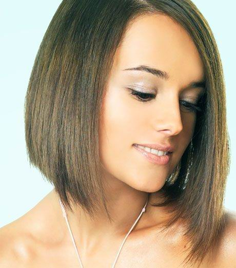 Layers can be cut into a medium bob hairstyle by first determining the