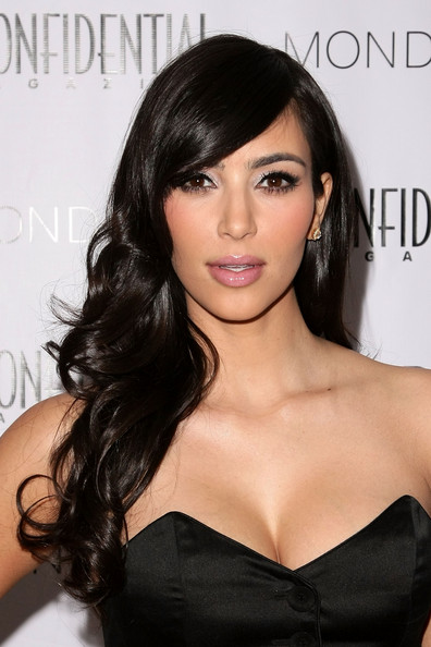 Kim Kardashian Hairstyles 2010. Should I try with black color hair for 2011?