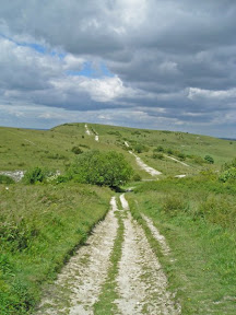 The start and end of the walk - on the left is the start, climbing up to Ivinghoe Beacon, and on the right ,looking for a place to wild camp as the sun goes down.