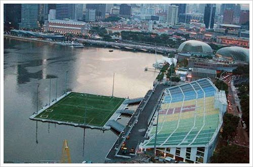 the attached photograph of a floating soccer field in singapore