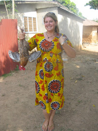 Me holding a live chicken on Thanskgiving before we killed it.